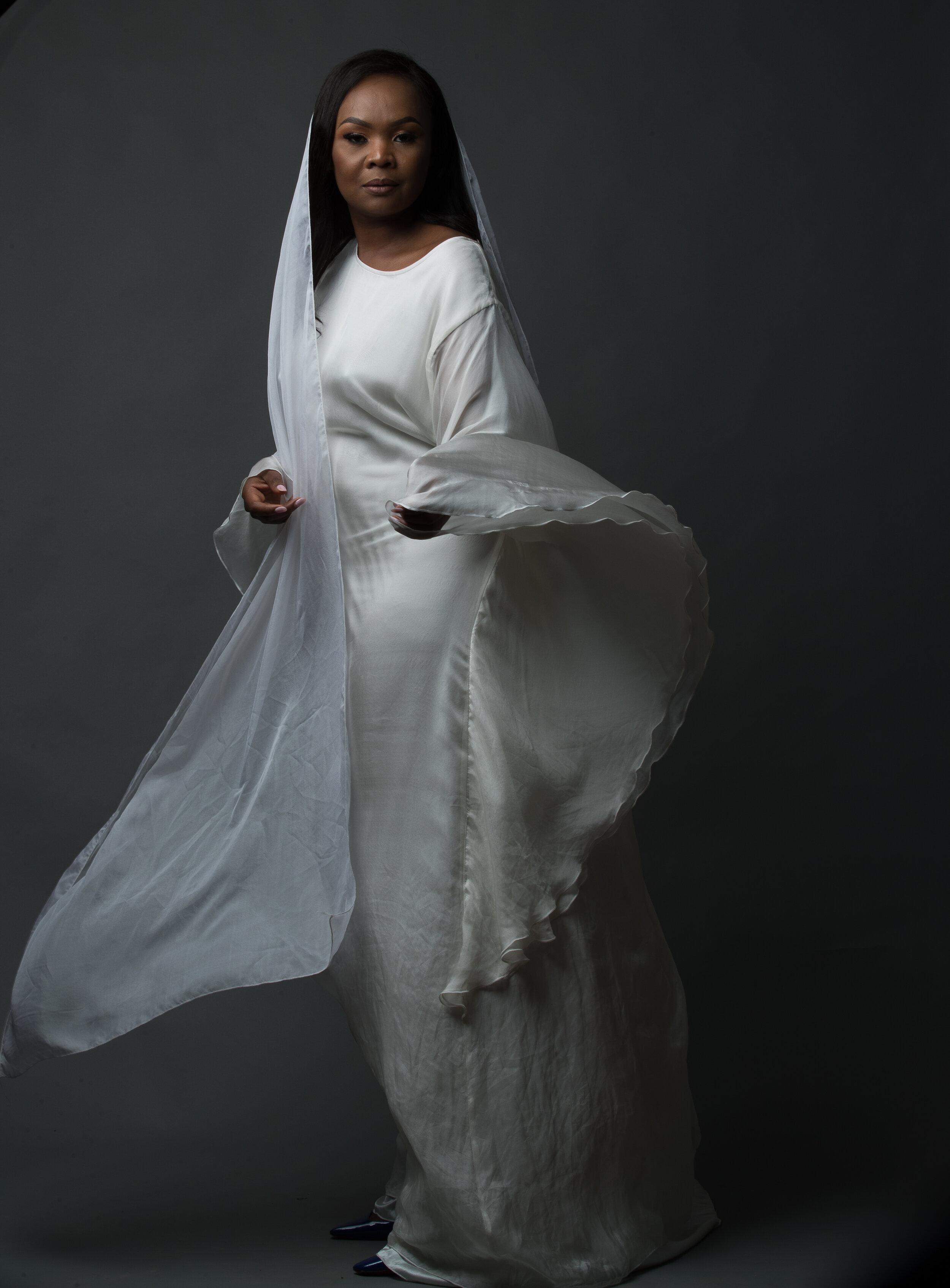 Ivory silk kaftan dress, £450  Silk chiffon  Silk satin lining  Dry clean only