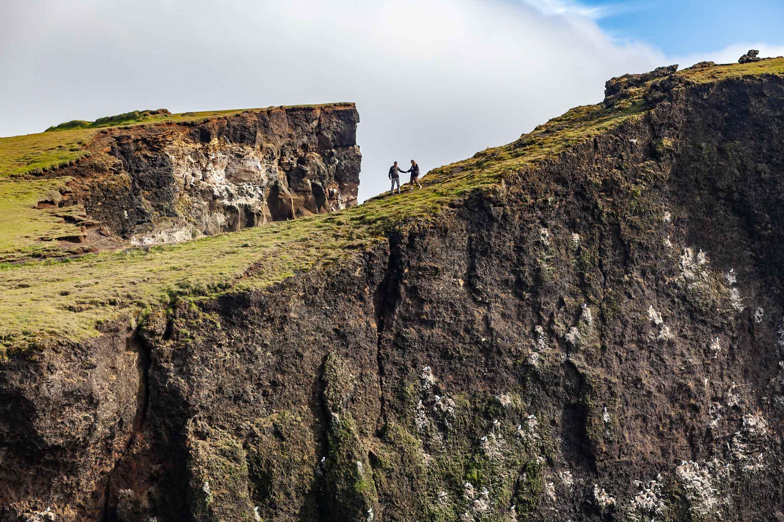 Hikers on Valahnúkar bird cliffs