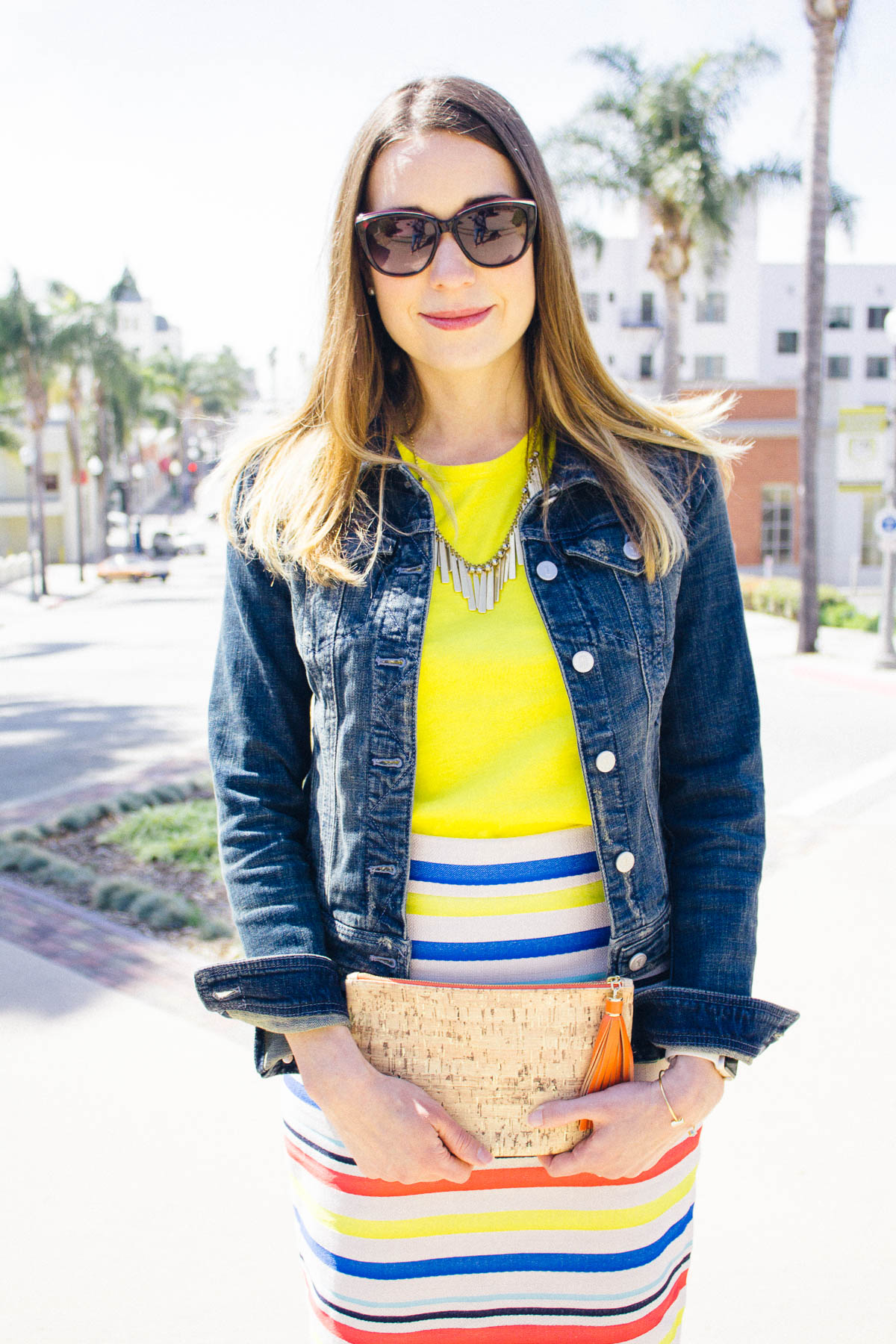 sunny bright yellow tee  // stripe skirt ( similar  and would look good with yellow tee) //  denim jacket  // statement necklace ( similar ) //  clutch