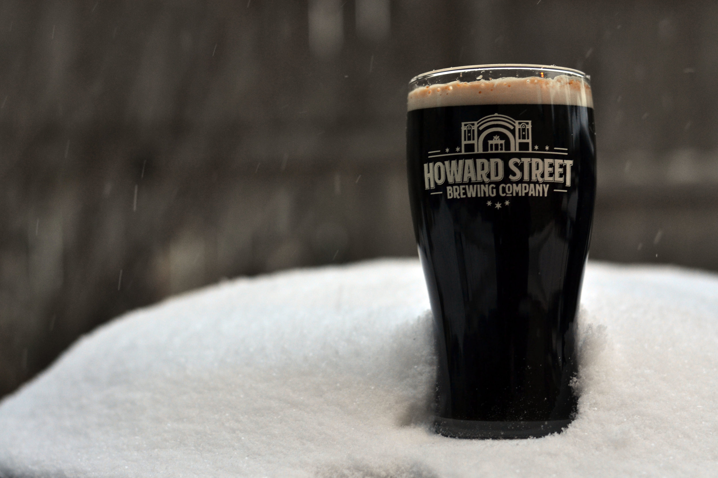 howard_street_brewing_stout_glass_in_snow.jpg