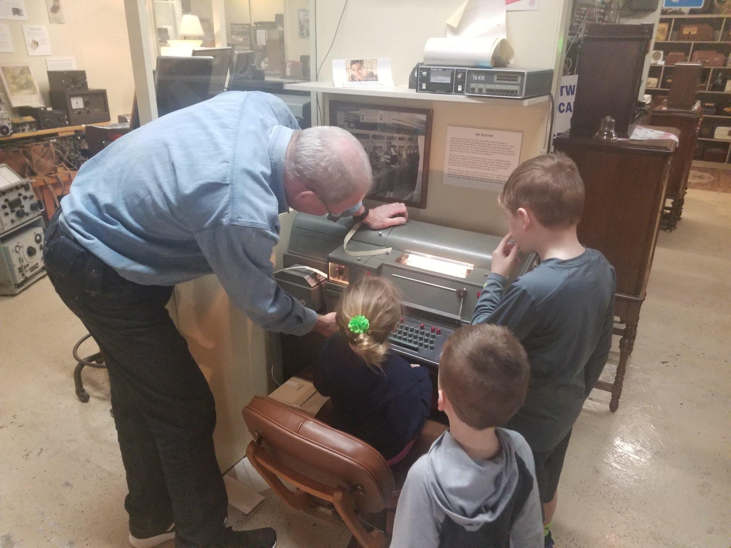 Explaining the Teletype machine.jpg