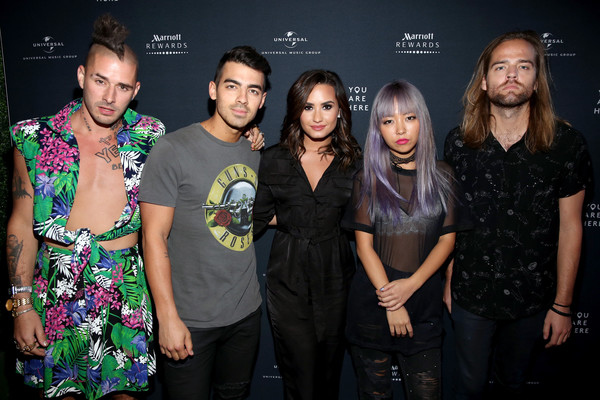 Demi with Joe's band, DNCE. Photo: Jonathan Leibson/Getty Images North America