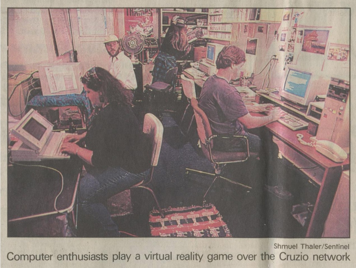 """Early geeks"" playing a Multi User Dungeons and Dragons game. Chris Neklason, one of the founders of Cruzio and still co-CEO, is on the right."