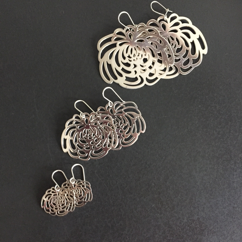 silver flower statement earrings.JPG