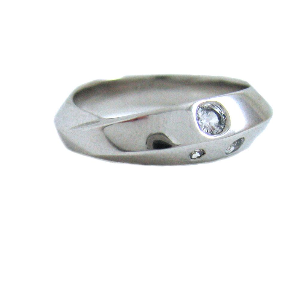 asymetrical platinum sapphire ring.jpg