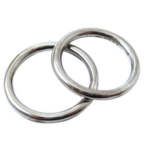 2.5mm round wire wedding rings.jpeg