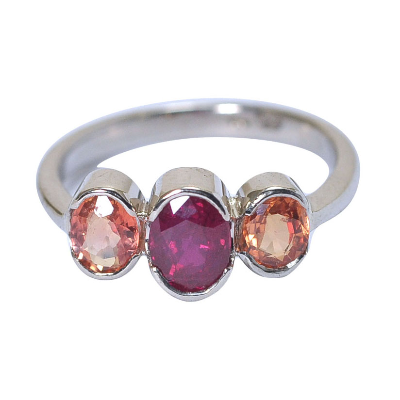 Ring open bezel set three oval faceted ruby orange sapphire .jpg