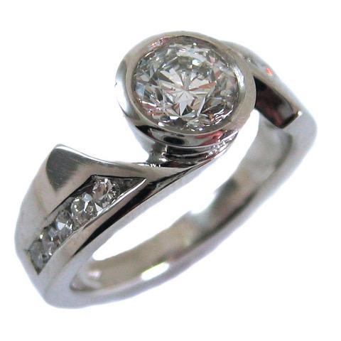 diamond channel set shoulders palladium ring.jpeg
