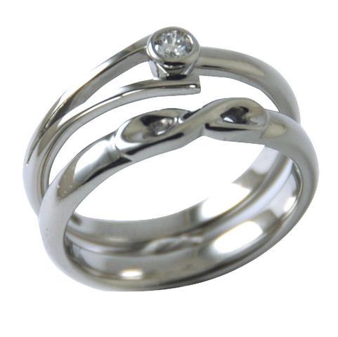 eiffel engagement and twist wedding ring.jpeg