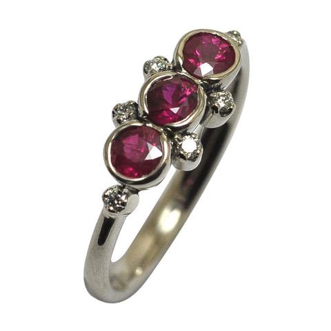 Ring white gold 3 round faceted open bezel set rubies diamonds.jpeg