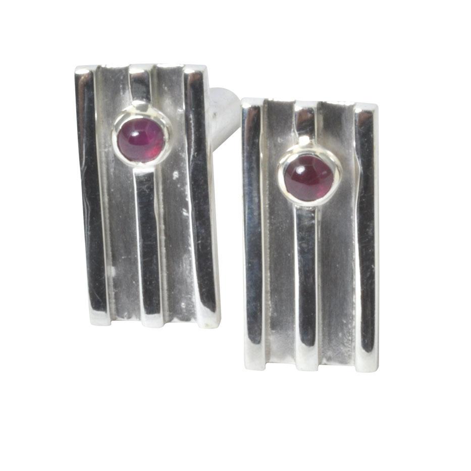 cricket silver cufflinks with ruby.jpg