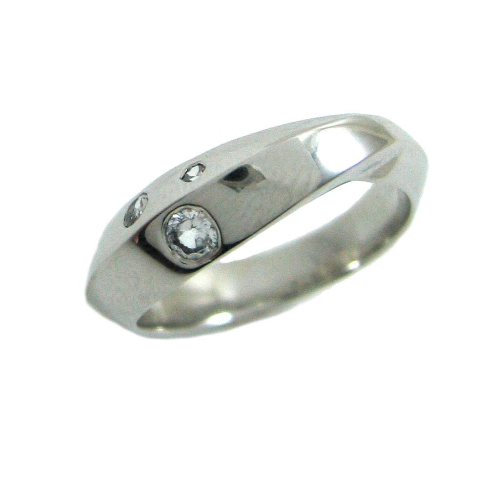 twist white sapphire ring.jpg