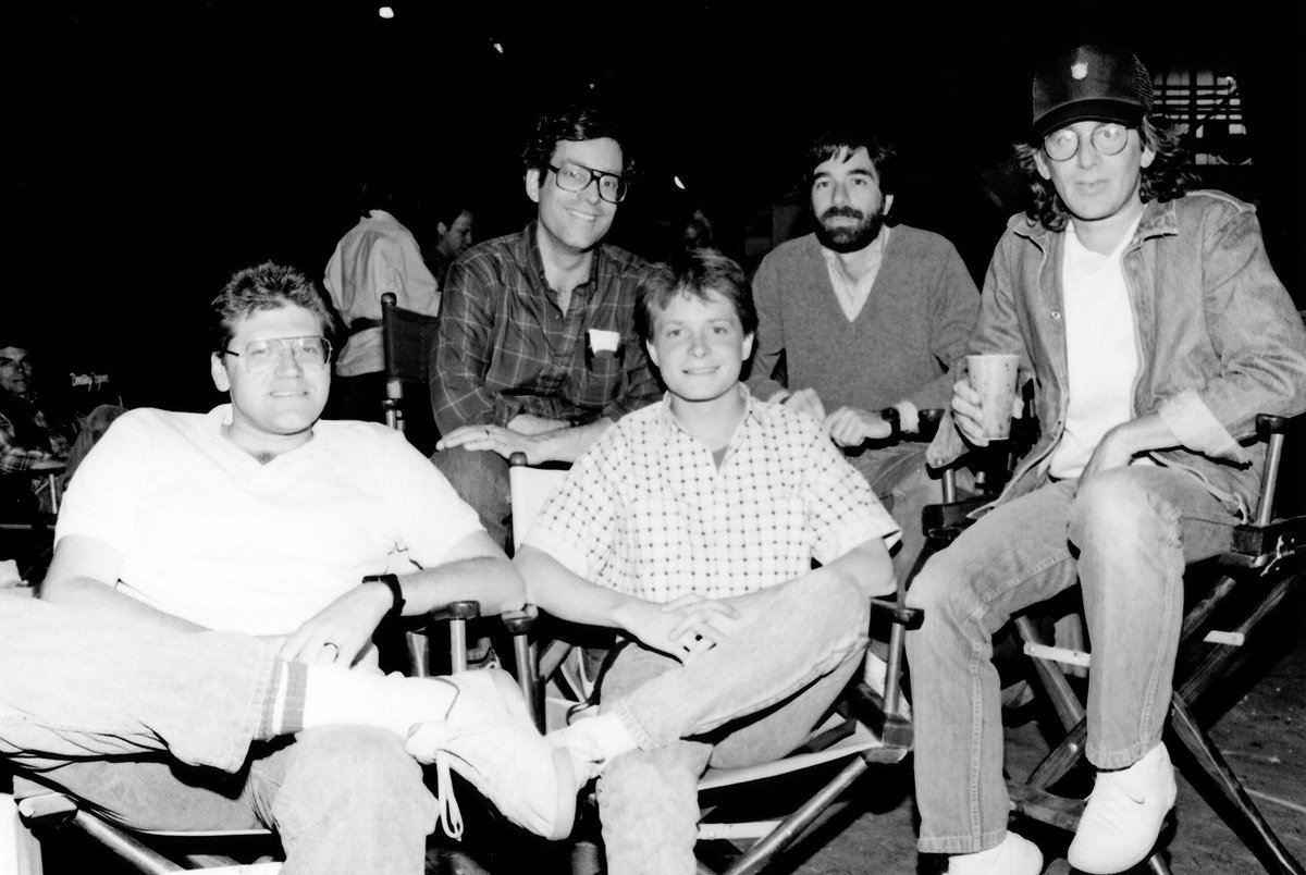 From Left to Right: Robert Zemeckis,  Bob Gale , Michael J. Fox, Neil Canton & Steven Spielberg, on the set of Back to the Future (1985)