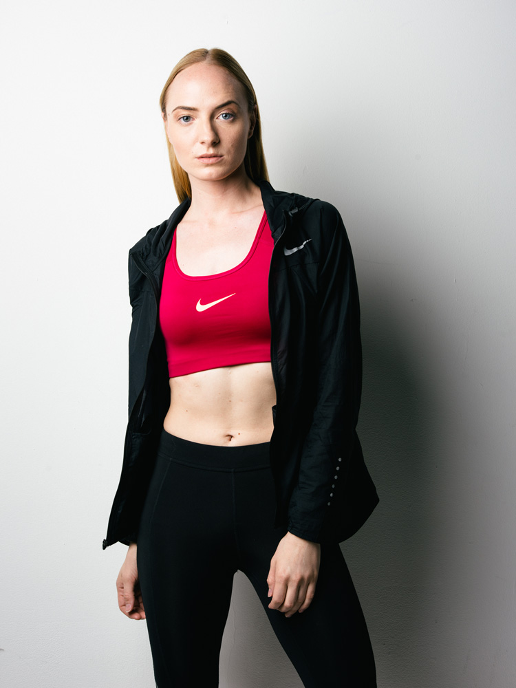 Editorial portrait of female track athlete wearing Nike sports bra and pants photographed in Atlanta by Jeff Walton Photography