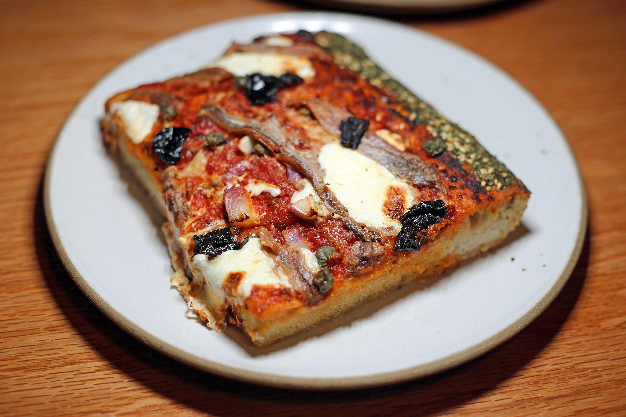 The Puttanesca: olives, anchovies, and furikake seasoning.
