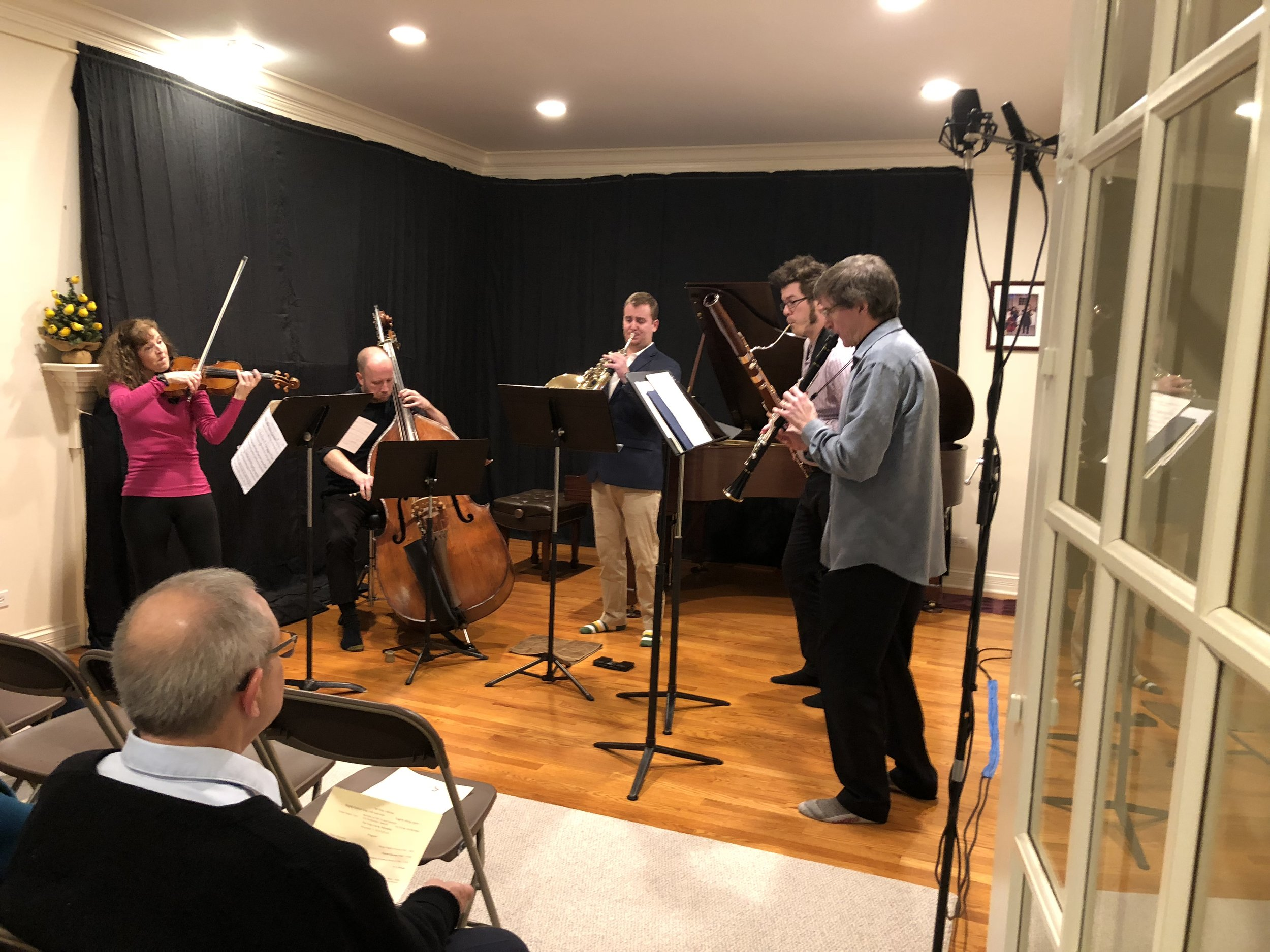Salon concert: Tad, right, performs with his wife Brigitte, left, alongside members of Fifth House Ensemble