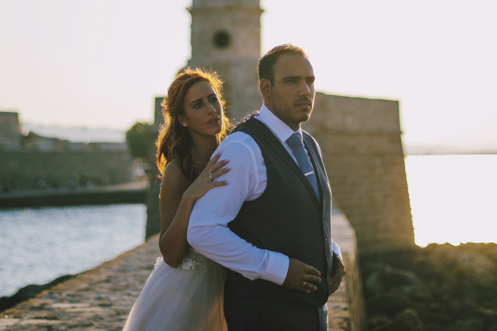 DIMITRA & GIORGOS, WEDDING IN PELOPONNESE AND CRETE  When this wonderful couple contacted me to be their wedding photographer, I was touched by their move and I was extremely happy! Giorgos is a good friend of mine and Dimitra is a big fan of my work and she is very interested in the Art of Photography as a whole. Wasting no time, we planned an amazing pre-wedding session, which you can see here and then we decided to close their wedding day with a next-day session at the magical island of Crete…