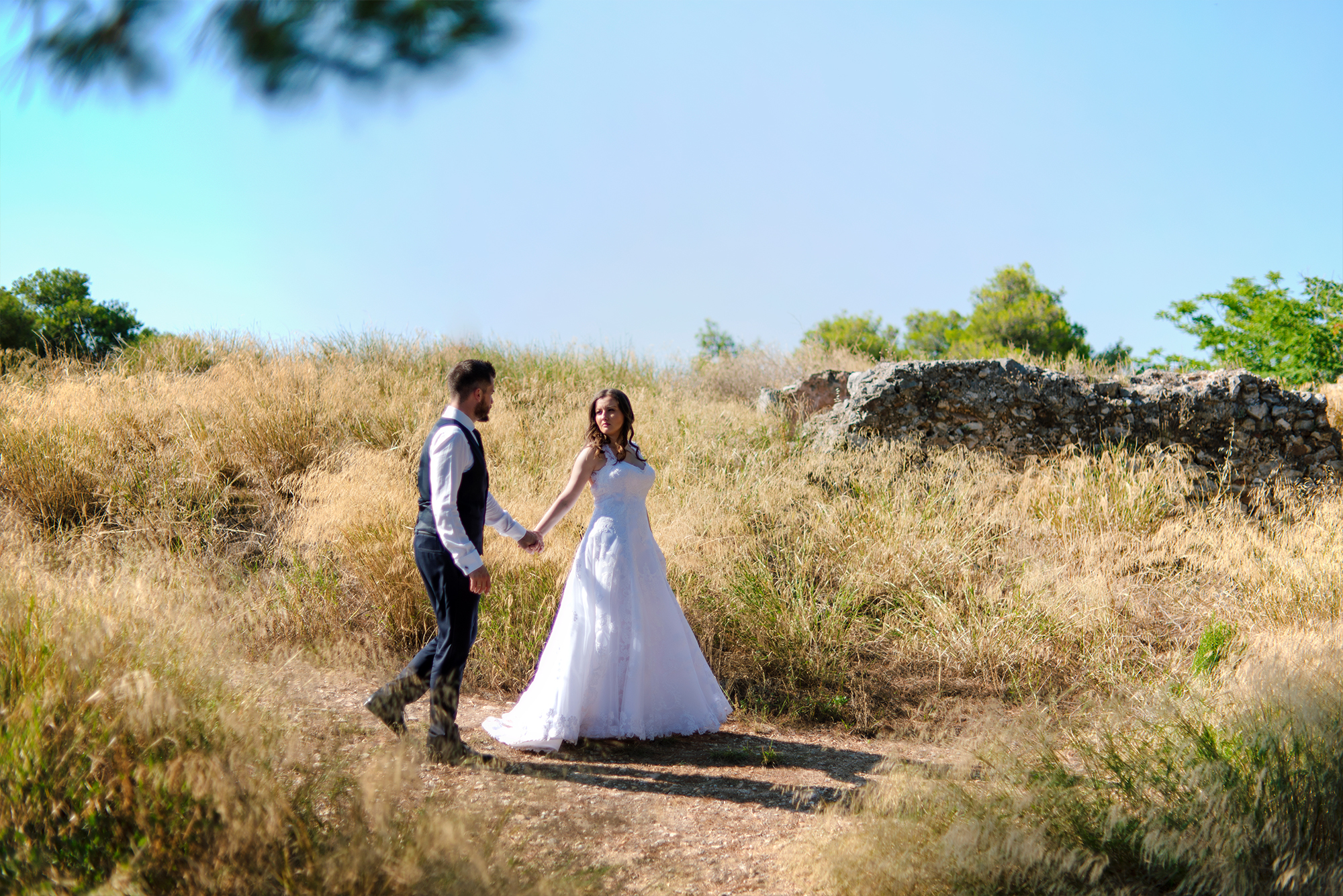 ANNA & VASILIS, WEDDING IN ATHENS AND NAFPLIO  Vasilis and Anna got married in Athens on a beautiful sunny day. They have been known each other since they were kids and that is why they can almost communicate by looking in each other's eyes. Who could have known that after so many years, they would get married and share a life together…