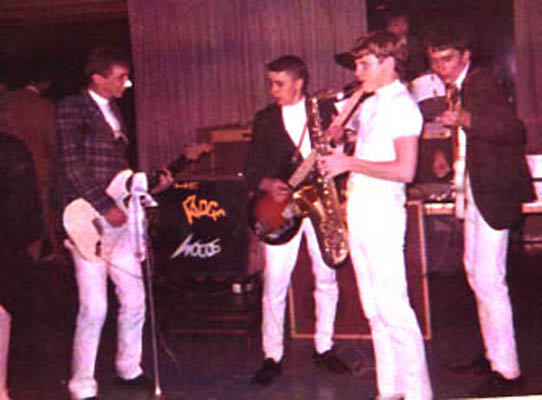 EARLIEST PHOTO - This is the earliest photo that I have. It's early 1964 at a church dance in Skaneateles.The late Lymie Wickwire is on the left, Bobby Dean is in the center, a sax-player that looks kind of familiar is next, Johnny Dean in the back is on the drums and the late Tom Dean on the right. The second pic is from one of the old P&C block dances in Skaneateles. That's Craig Bennett on the left, Johnny on drums, me with my mouth open and my eyes closed, Bobby and Tommy.The rest of the history is as follows. Lymie would leave to go into the service, he would be replaced by Craig Bennett. Bobby would leave to go to college and be replaced by Barry Maturevitz. Johnny would take over lead guitar and Al Klimak would join on drums. Tommy would leave to go to college and be replaced by Holly Gregg thus completing the 'Ridgewood Saga' by the end of 1966.Dig the cool drum head! Photos by Catherine Cain.