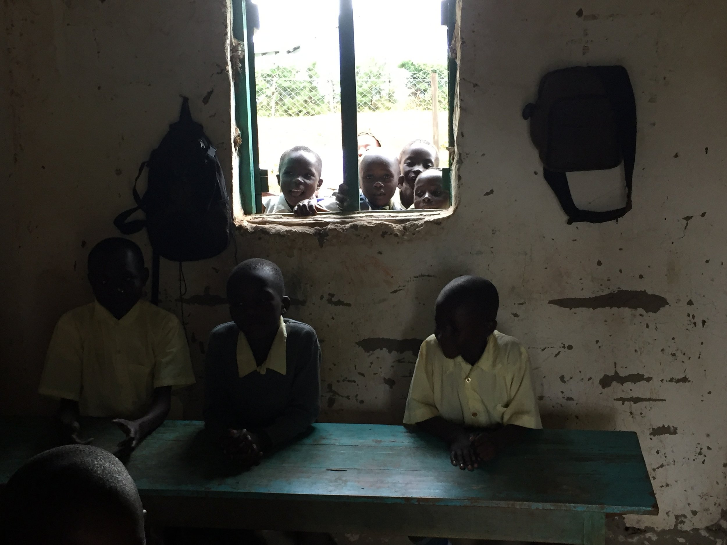 The classrooms were pretty small and had a single window. When the teacher wasn't instructing, students liked to gather in the windows to talk to their classmates in the rooms.