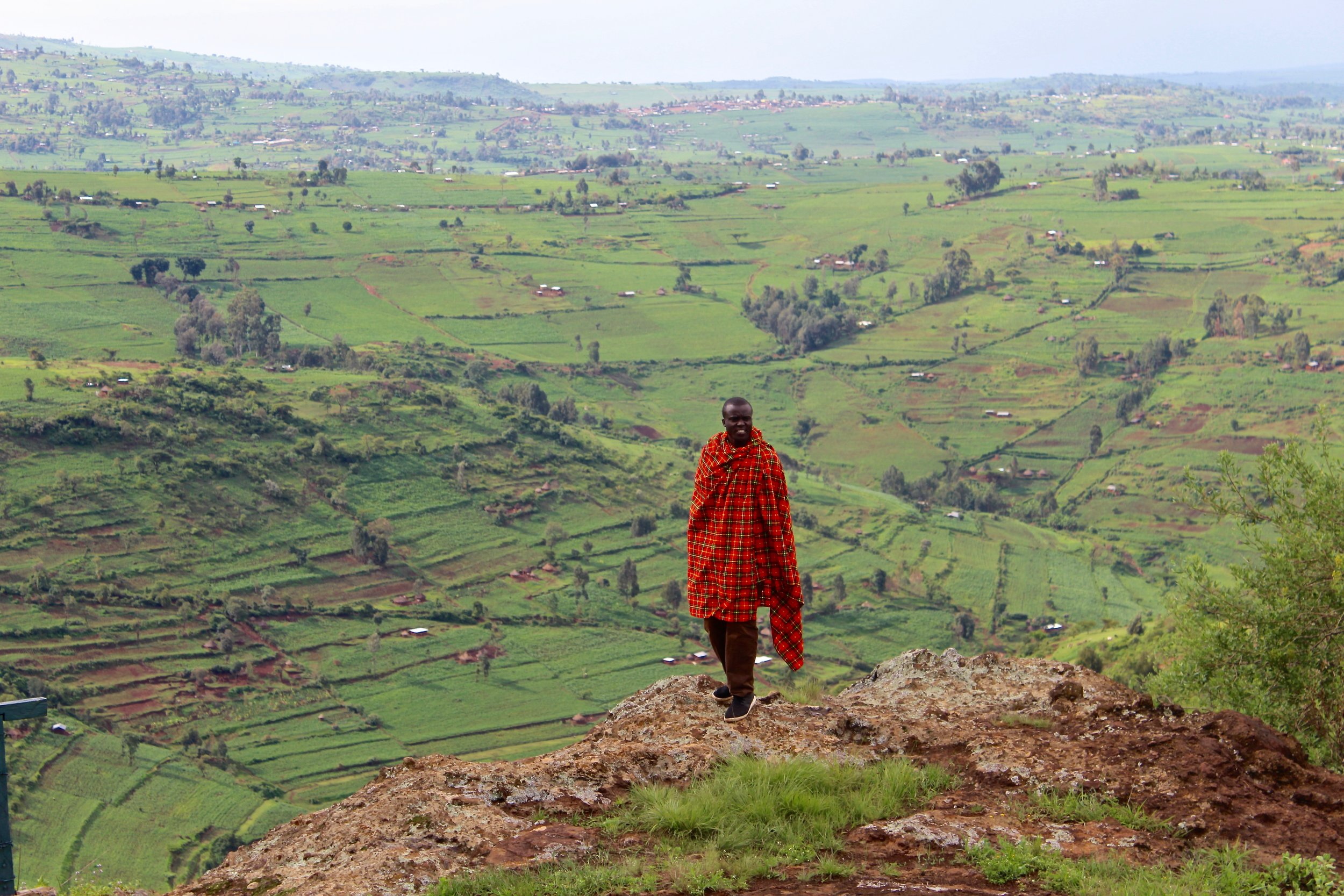 This was our favorite overlook at Mt. Elgon. Livingstone is posed with the Kenyan countryside in the background. If you look closely, you can see fields and houses.