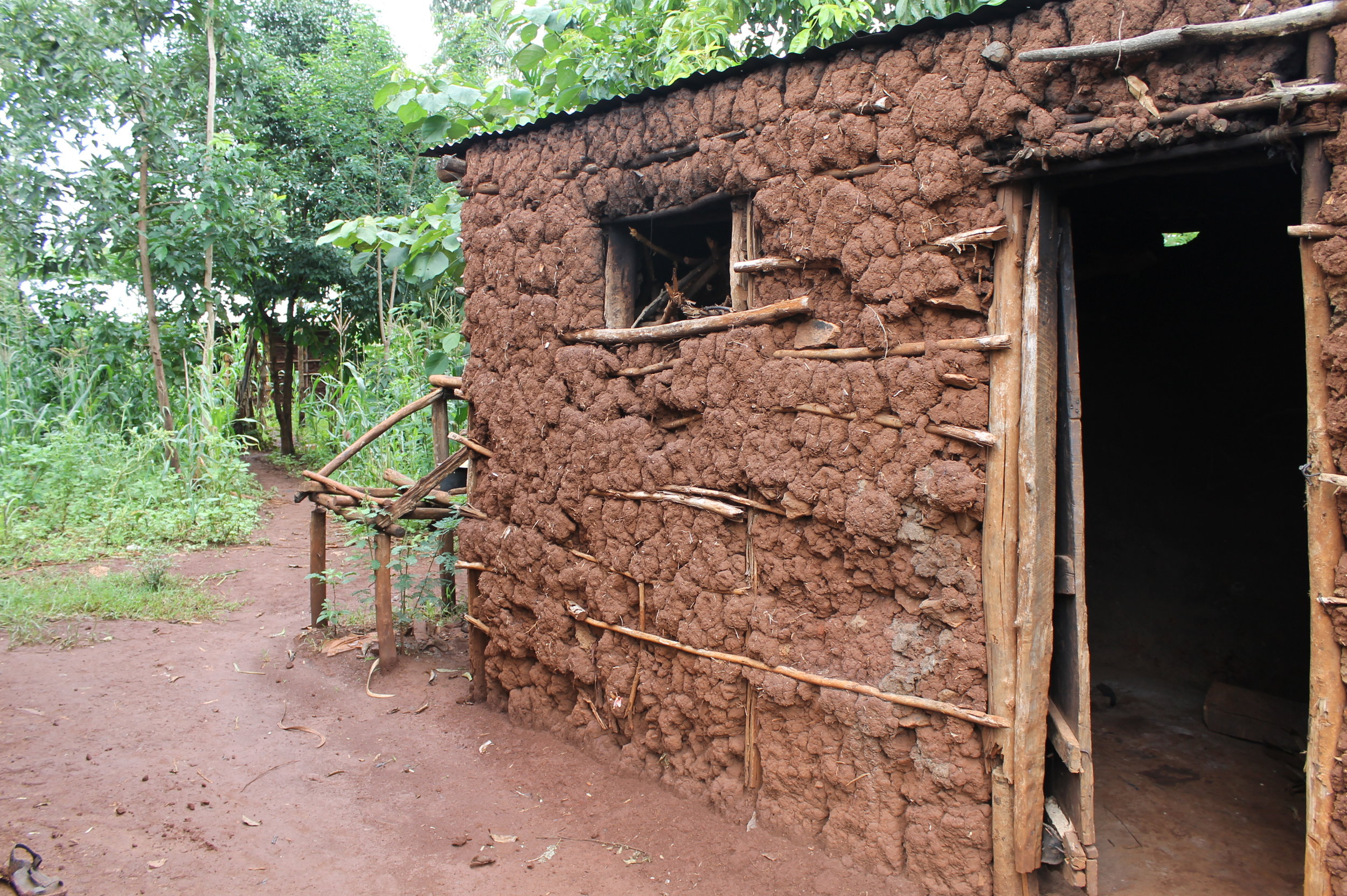 We loved this picture because it shows how much work goes into creating the houses in the Kimilili community. First, a wooden frame must be constructed, and then it must be packed with a mixture of mud and hay.