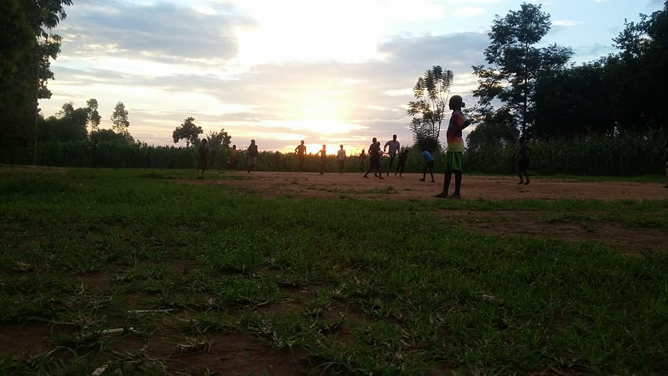 Members of the community gathered on the schools soccer pitch to play a game at sunset.