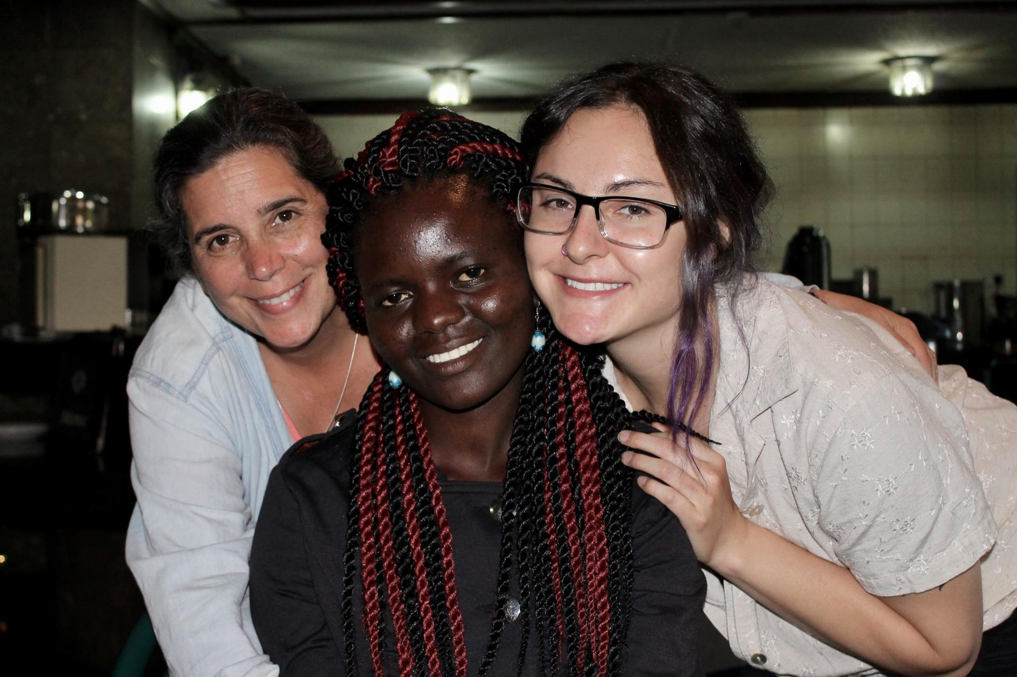 Esther, Livingstone's sister, came with us to Nairobi. There, Brooke and Melissa accompanied her while she got her hair done.