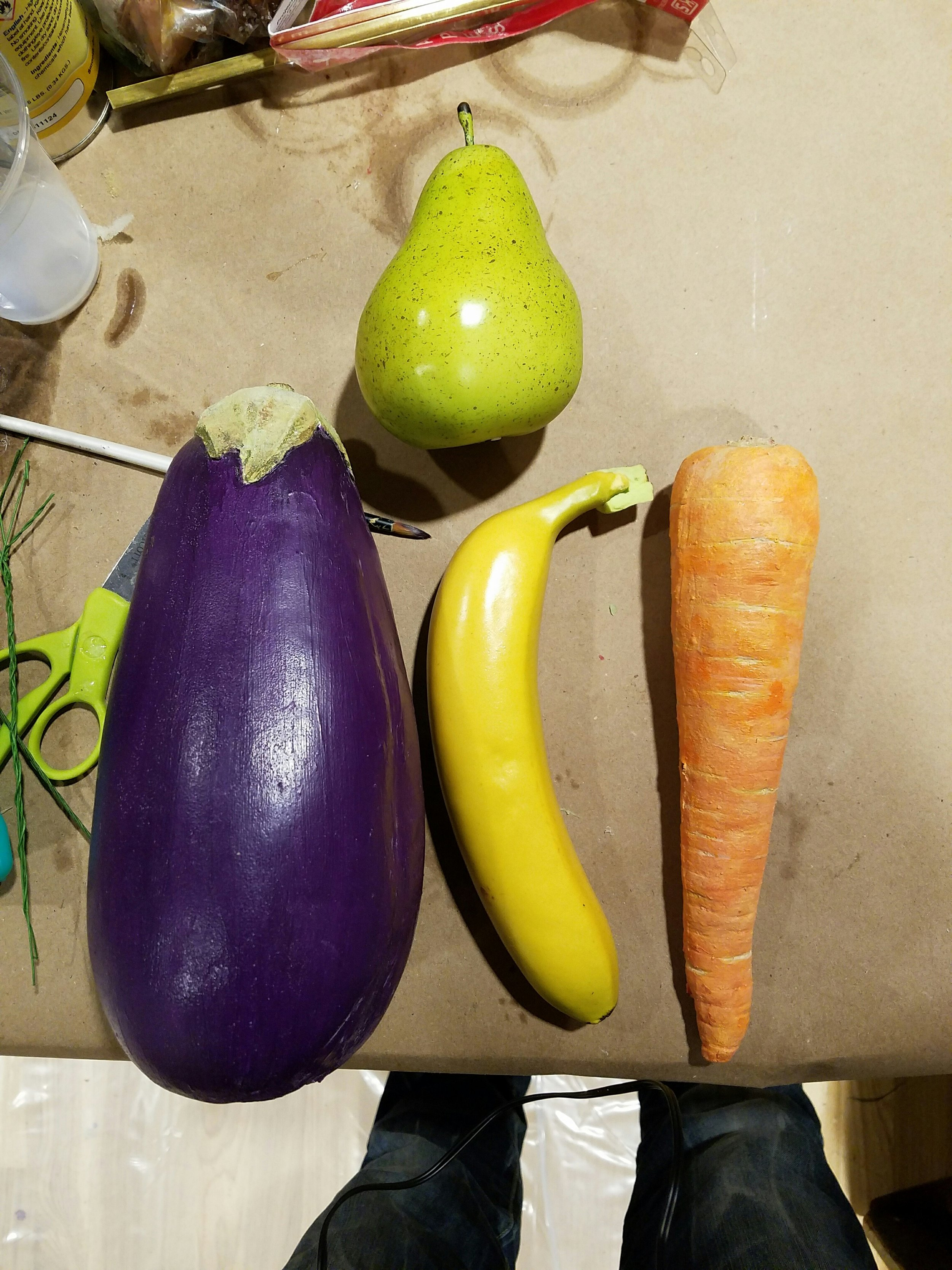 A real eggplant and carrot were molded, and then cast using urethane foam, and painted up to look like the real thing