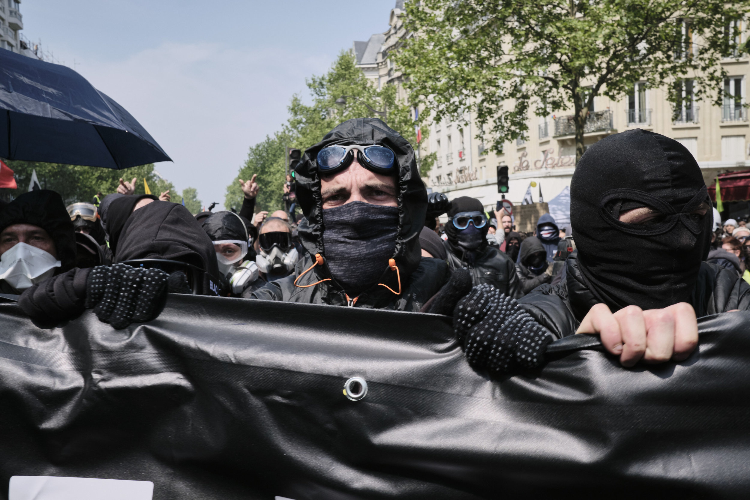 Anti-fascist participants of the protests holding a banner in front of the police.