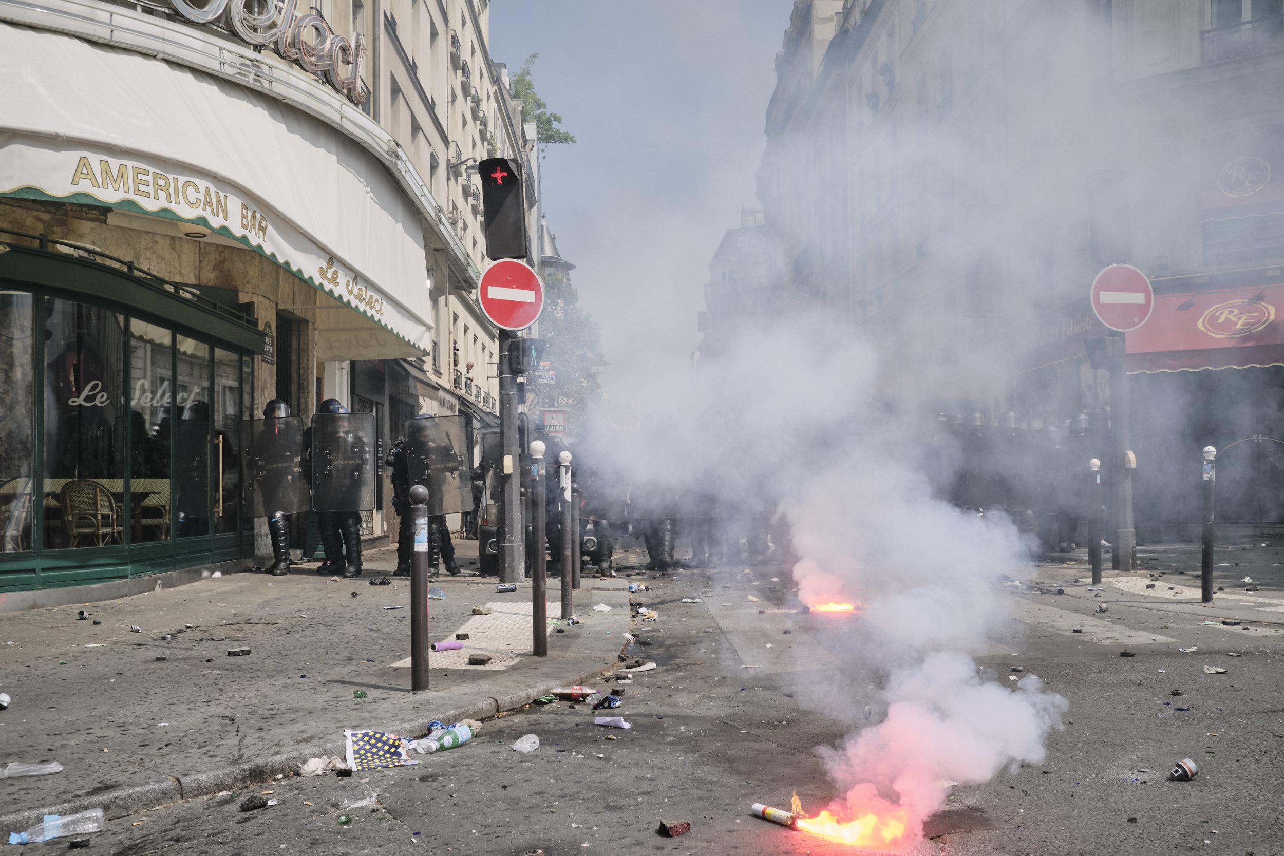 Light flairs burning after a confrontation between the protesters and the police at Boulevard du Montparnasse.