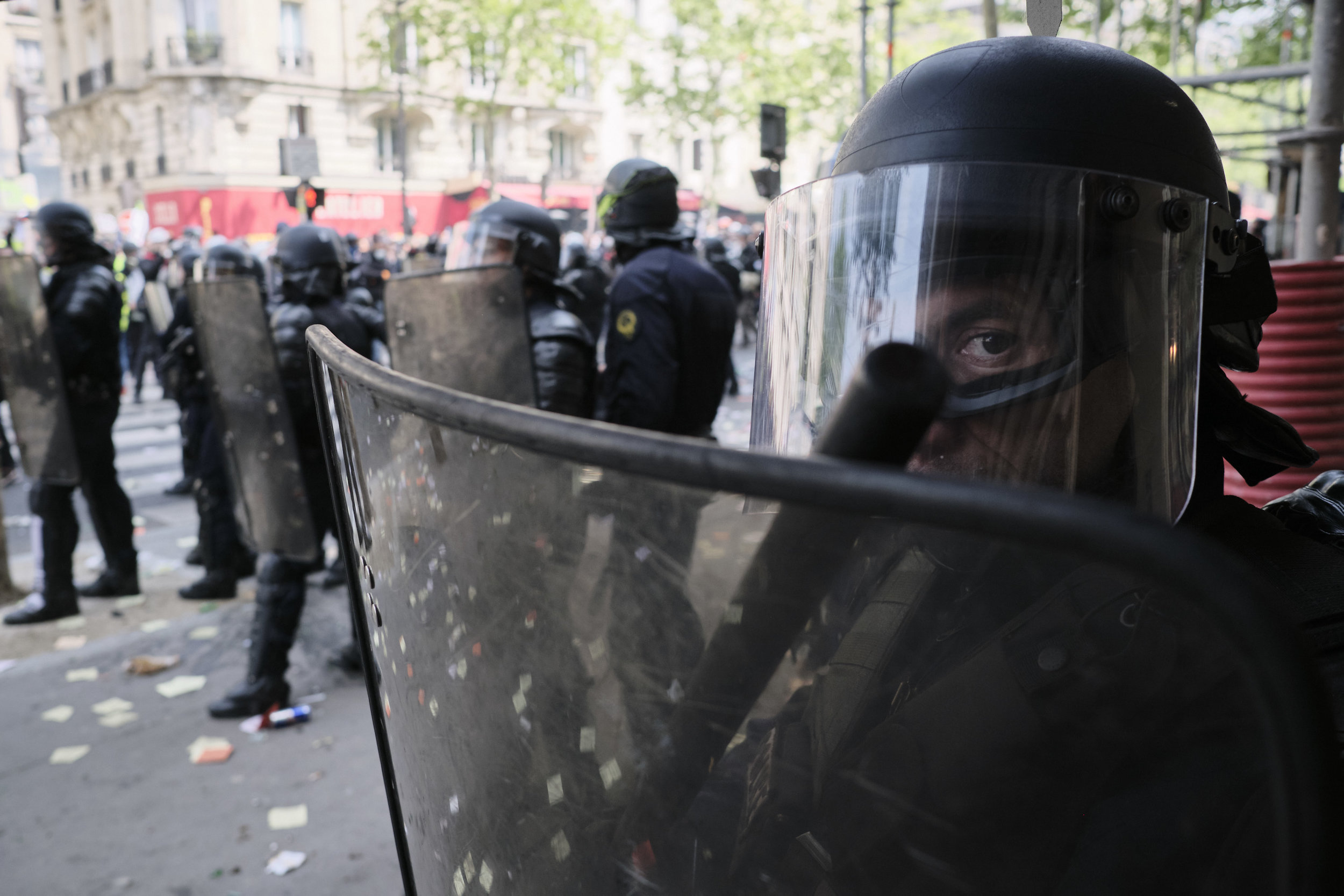 Riot police officer on edge after a violent confrontation with the protesters atBoulevard du Montparnasse.