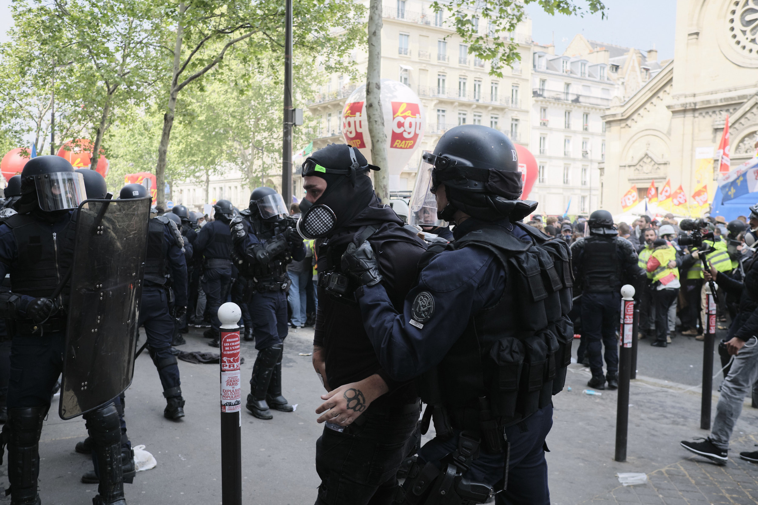 Anti-fascist protest participant being arrested by the riot police during the confrontation between the police and protesters at Boulevard du Montparnasse.