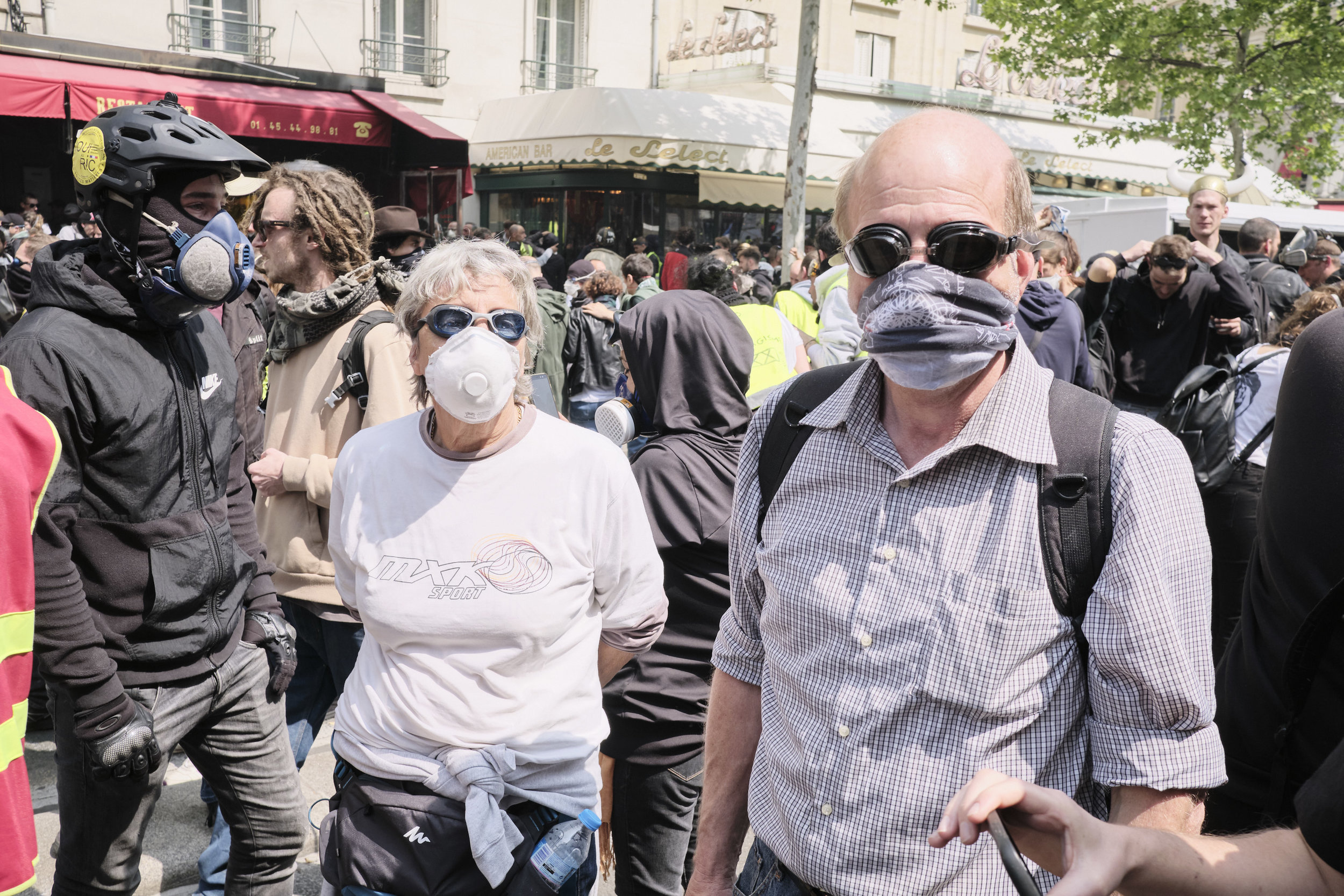 An elderly couple of protest participants with their makeshift protective equipment from the tear gasat Boulevard du Montparnasse.