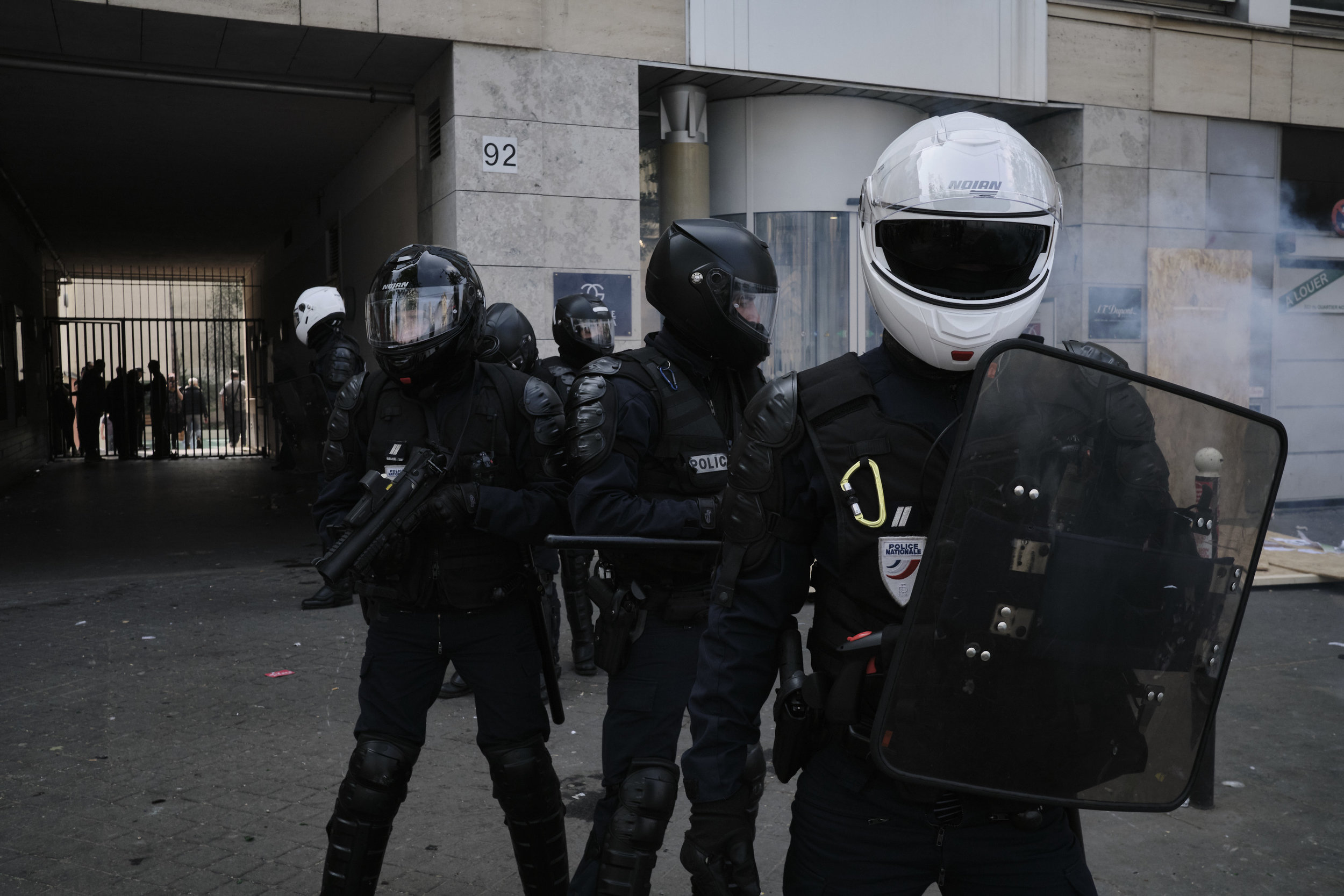 Riot police officer on edge after a violent confrontation with the protesters at Boulevard du Montparnasse.