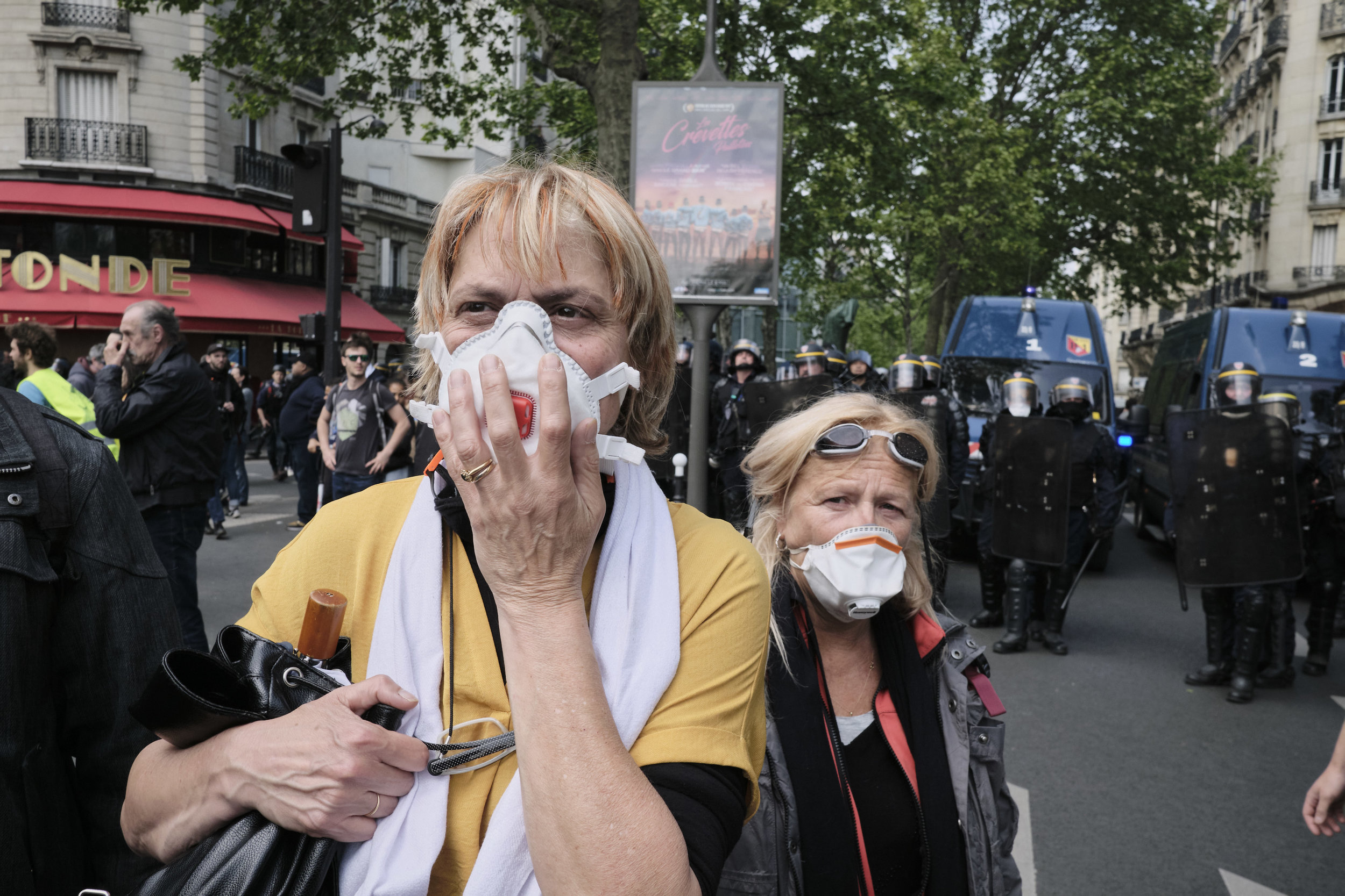 Protest participants trying to get away from the tear gas fired by the police in attempt to control the crowds at Boulevard du Montparnasse.