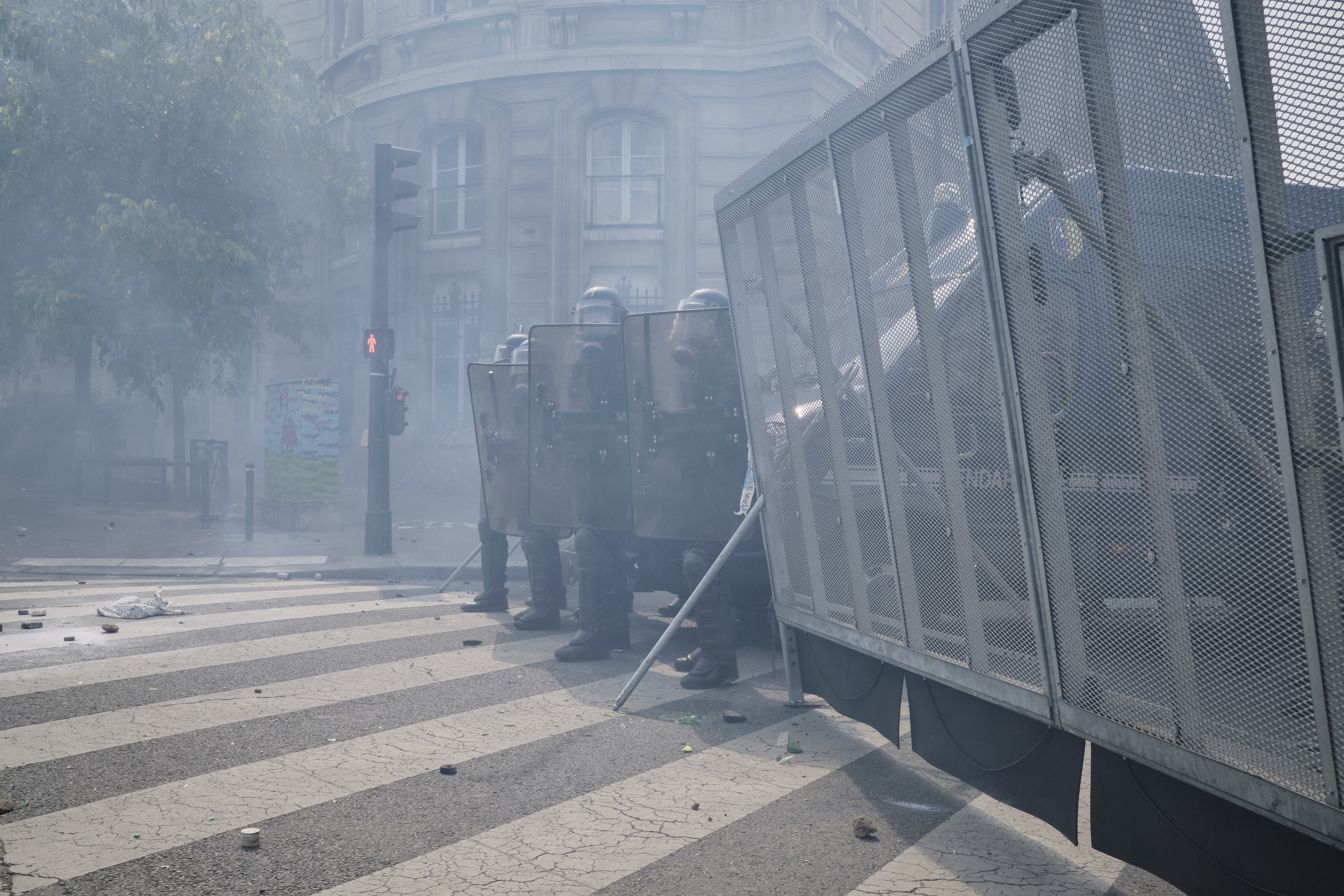 Police trying to divert the protest route towards The Place D'italie. Tear gas is still in the air after an attempt to control the crowd.