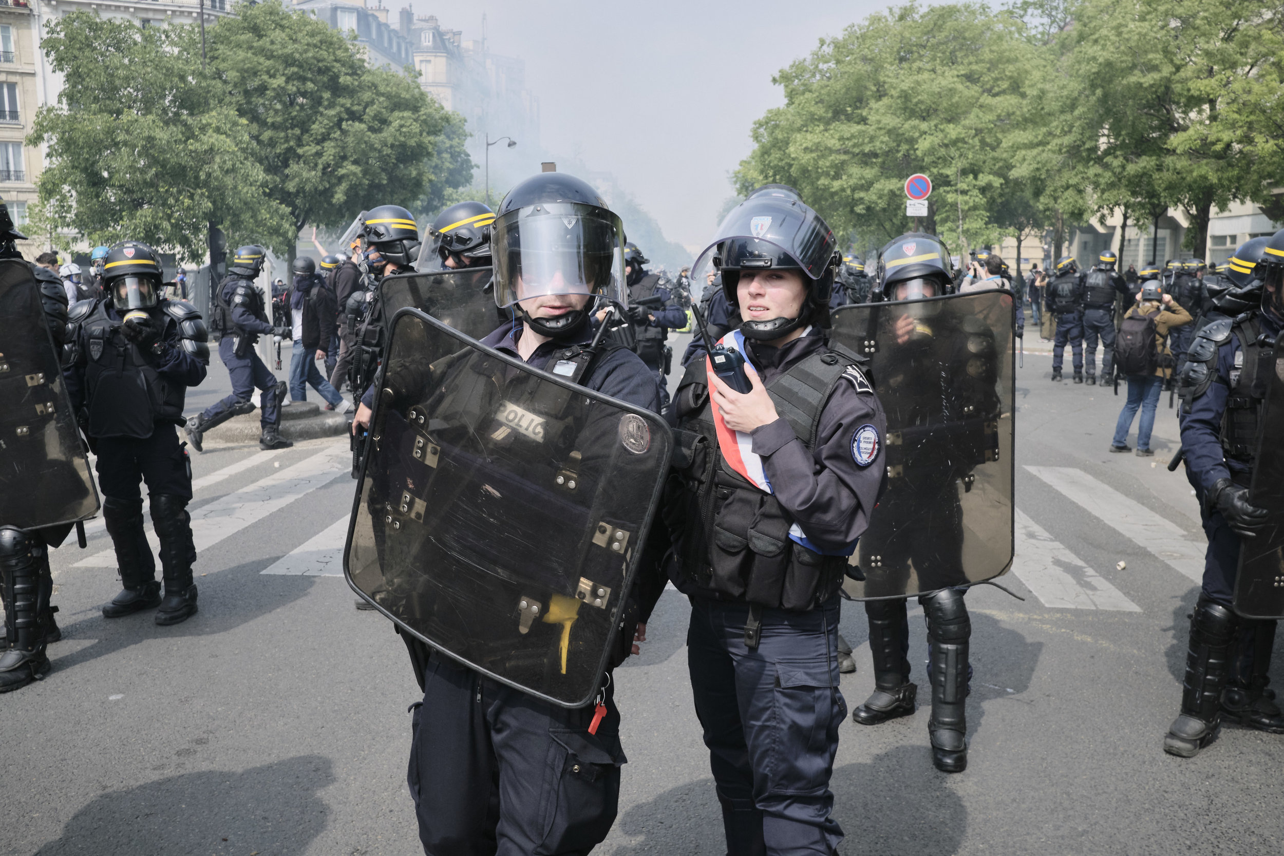 Officers discussing their plans to divert the protests and control the crowds during the march to The Place D'italie.