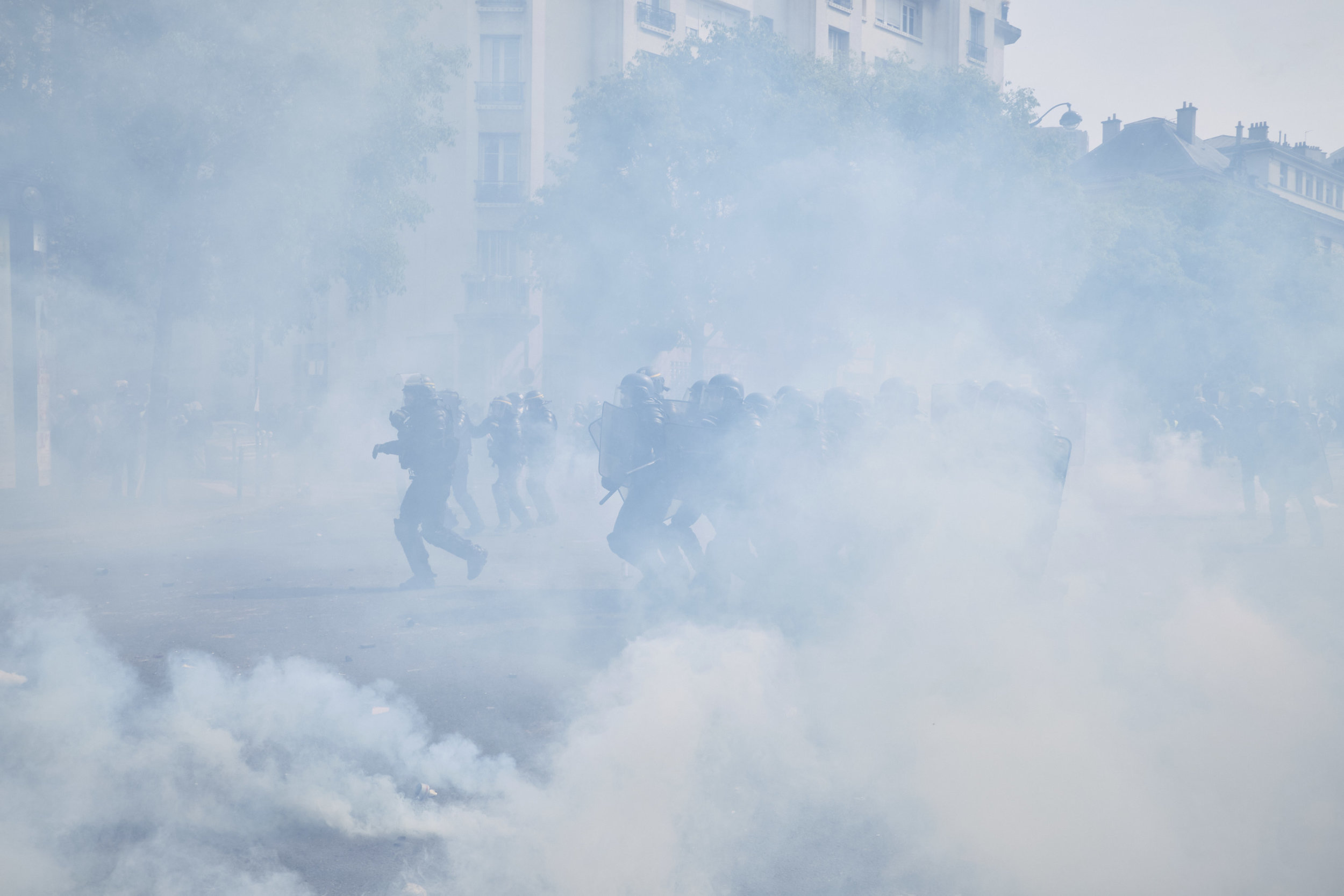 Riot police pushing the crowd of protesters further into The Avenue des Gebelins in order to disperse the blockade.