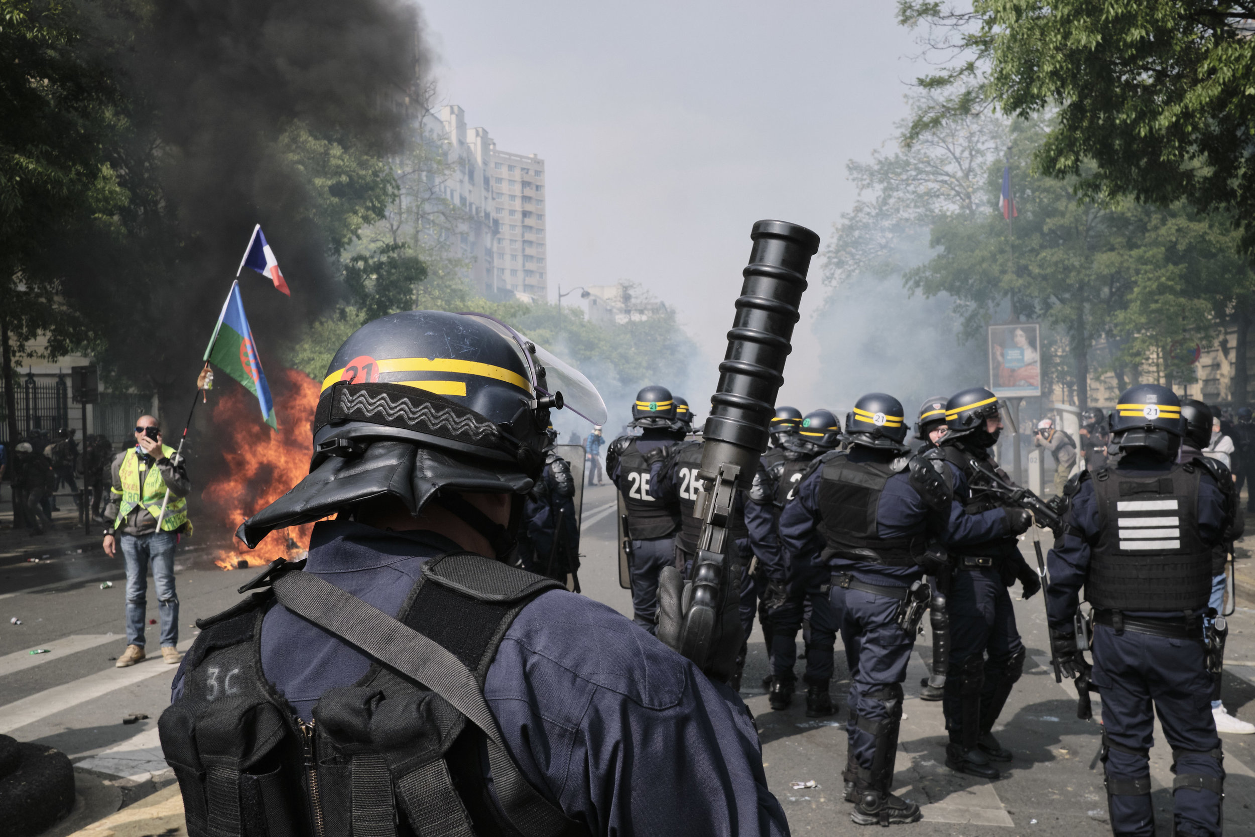 Riot police pushing the crowd of protesters further into The Avenue des Gebelins inorder to disperse the blockade and extinguish the fire.