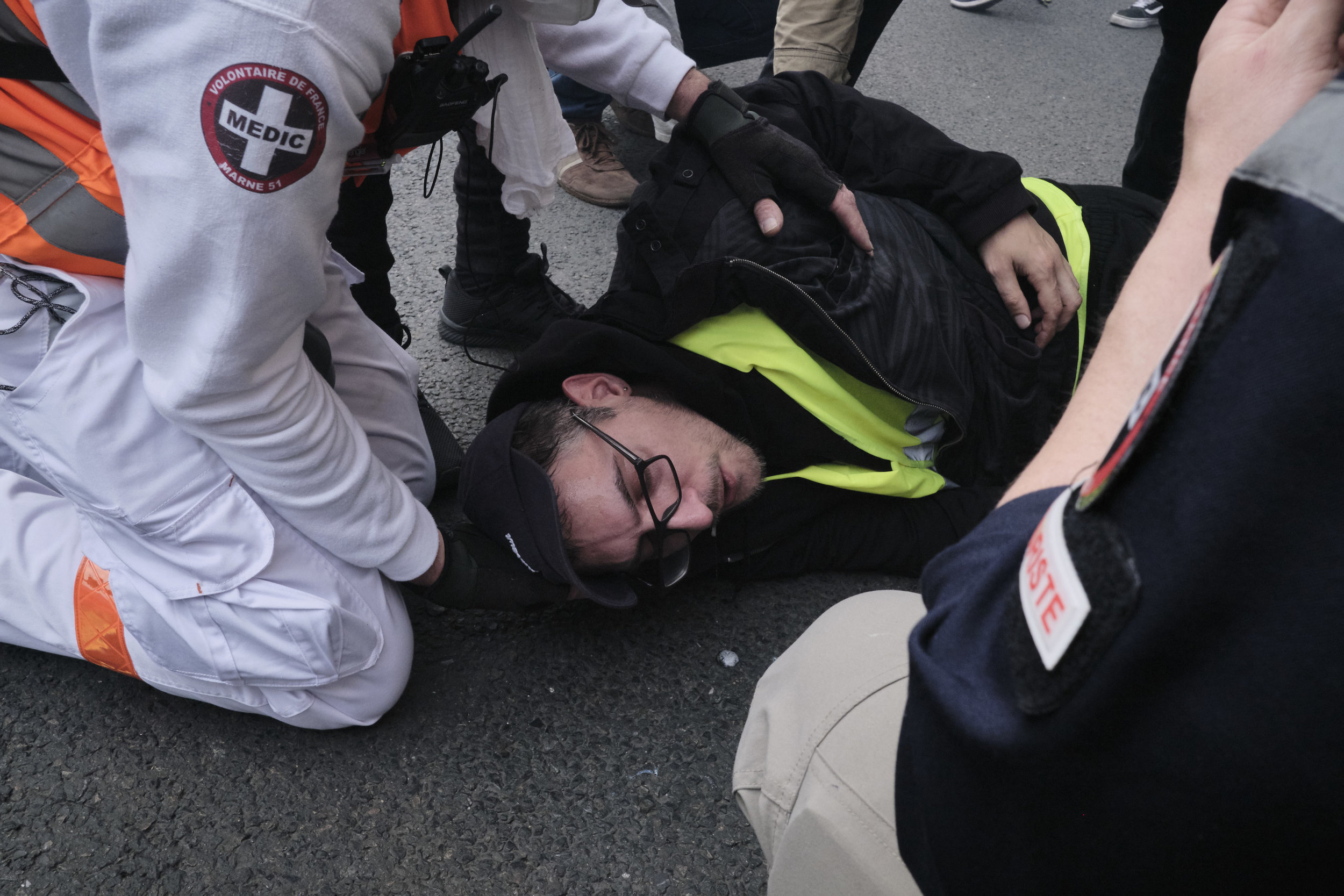 Street Medics helping an injured protest participant after a confrontation with the police.