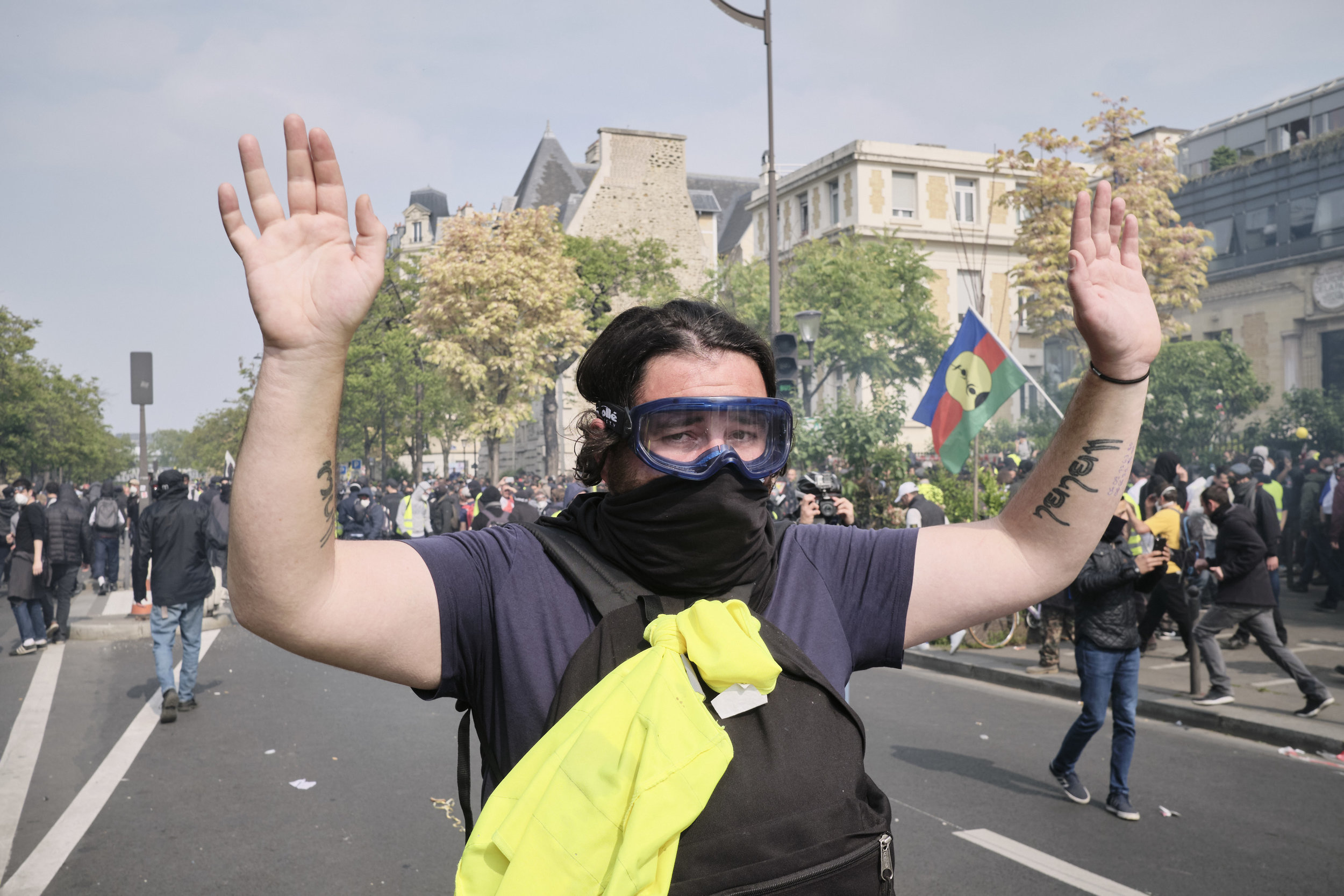 Protester is holding his hands up as a sign of surrender and peace after a violent confrontation with the police at The Boulevard Arago.