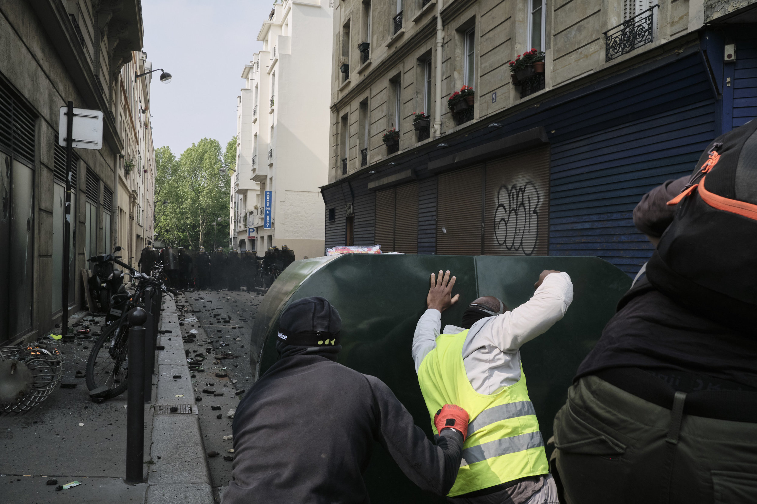 Protesters pushing the police away with their mobile blockade during a violent confrontation at The Boulevard Arago.