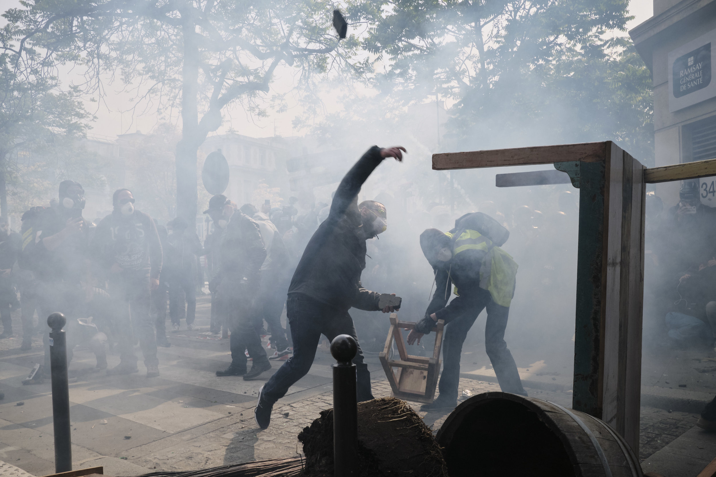 Protesters throwing rocks at the police during a violent confrontation at The Boulevard Arago.