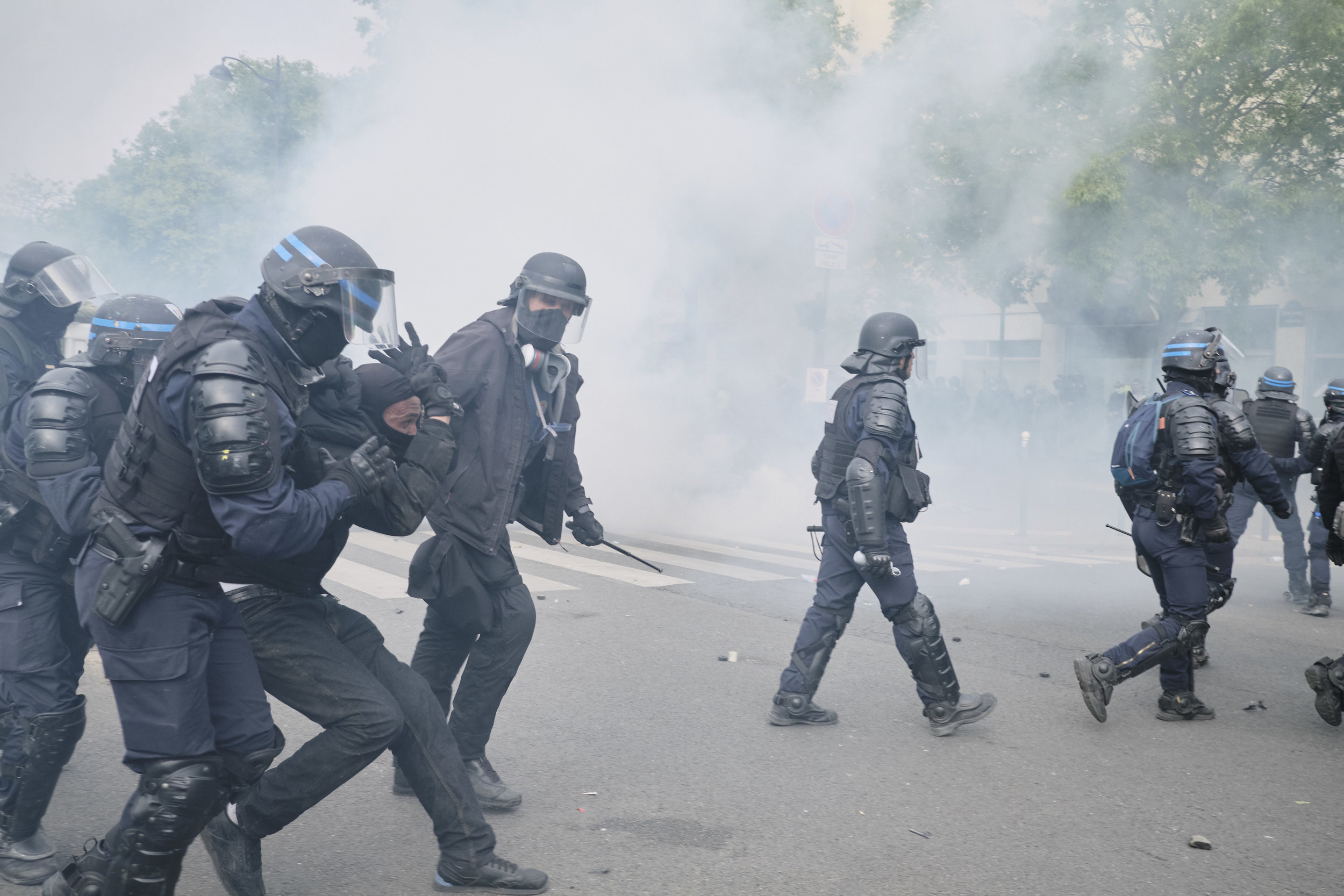 Anti-fascist protest participant being arrested during a violent confrontation with the police at The Avenue des Gobelins.
