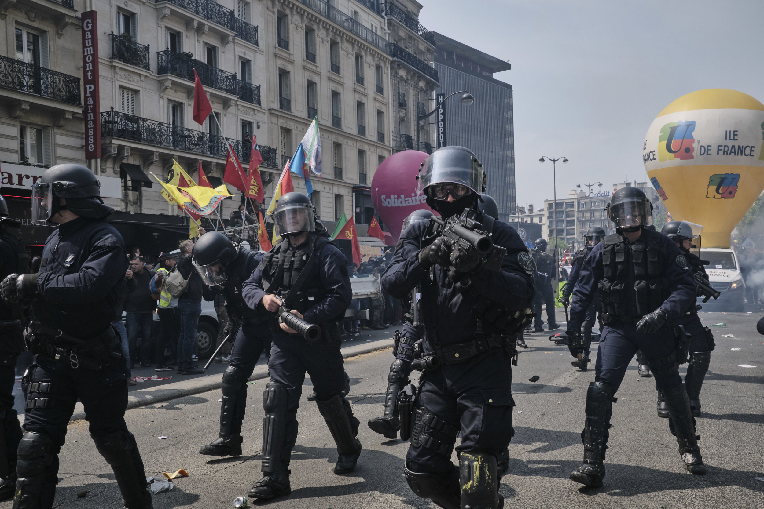 Police marching up The Boulevard du Montparnasse after an attempt to control the crows.