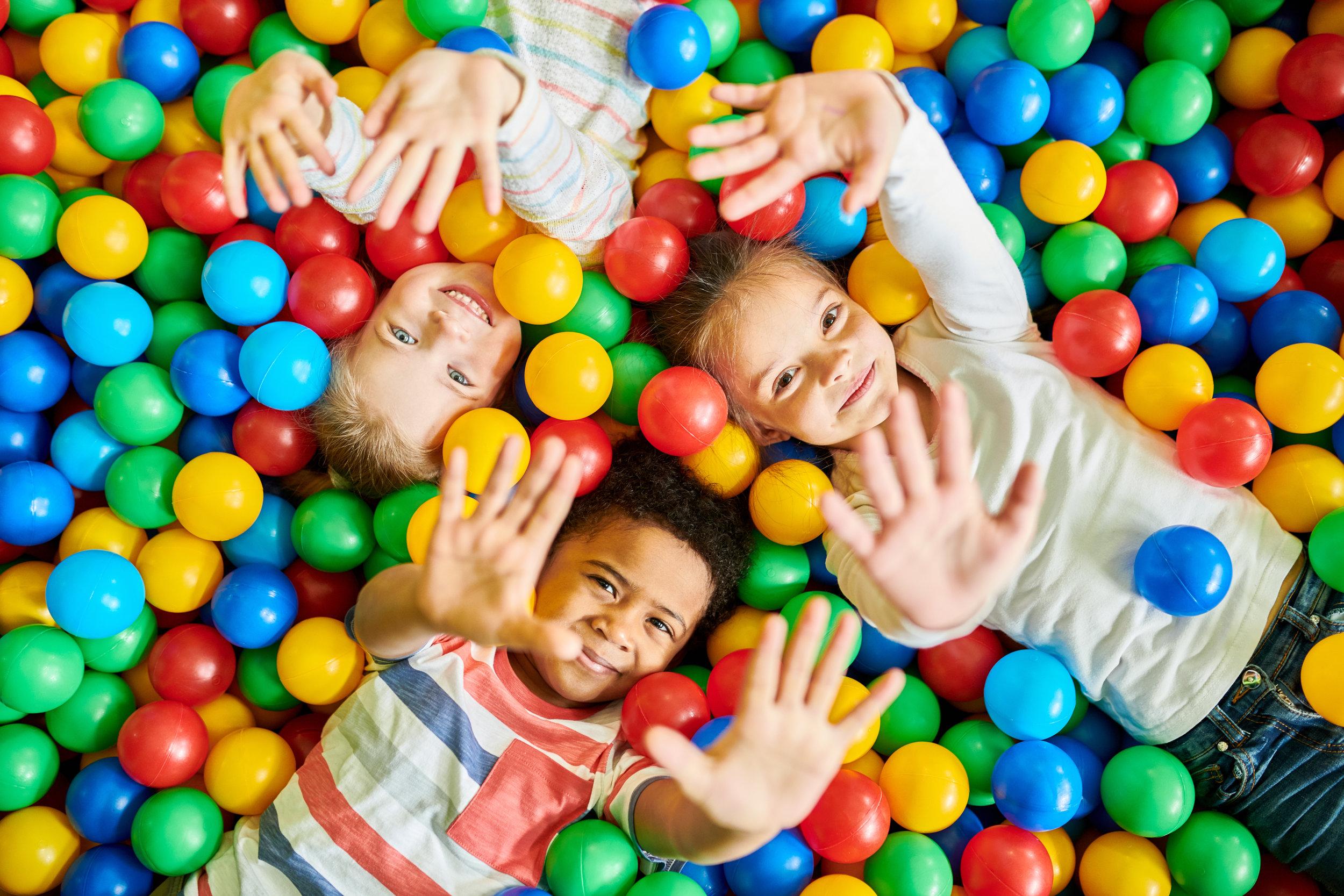ball pit playing AdobeStock_211577338.jpeg