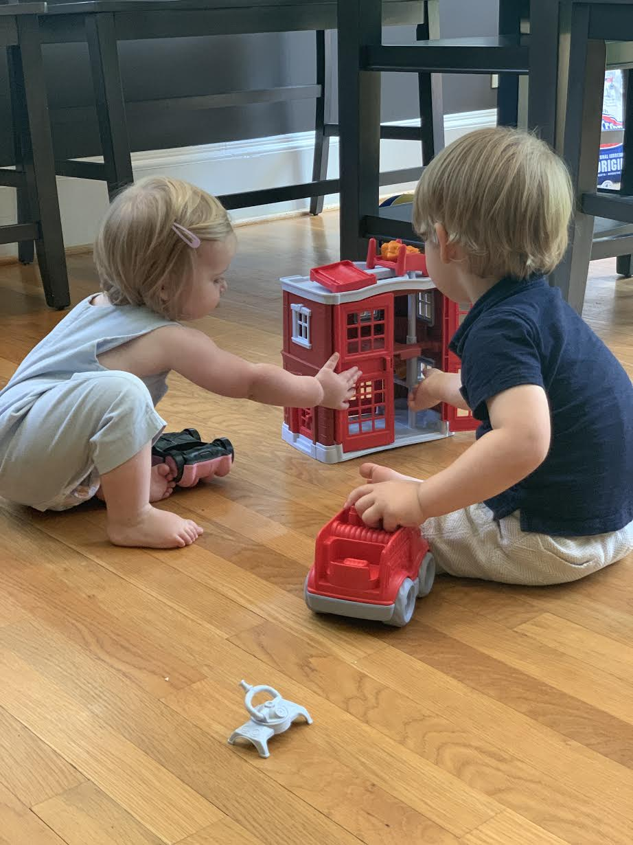 Joseph and Isabel playing with his new fire station.