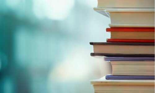 stack-of-books-against-blue-background.jpg
