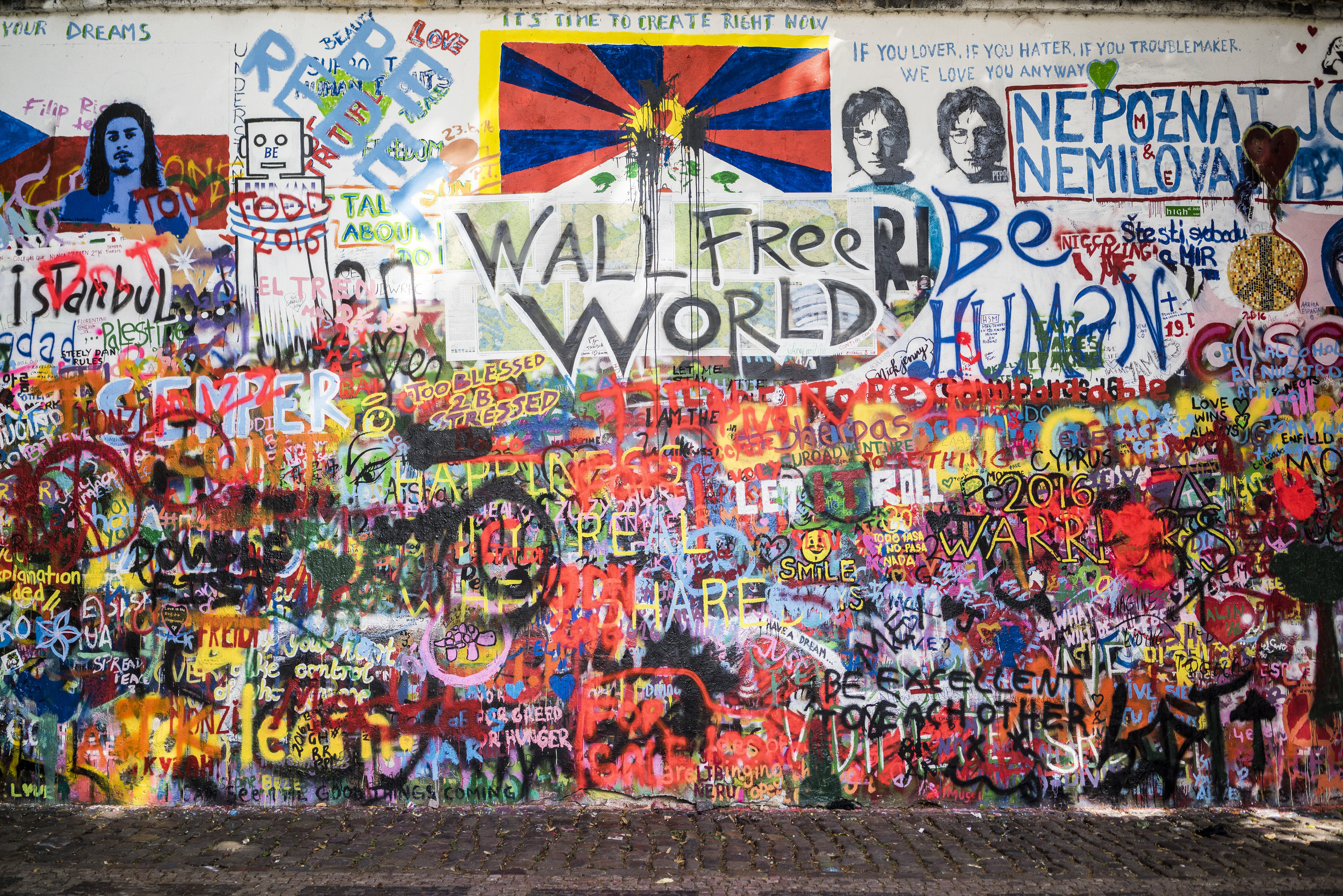 "Photo by Adi Goldstein Iconic graffiti at the Lennon Wall: ""Wall Free World,"" ""Be excellent to each other."" Prague, Czech Republic"